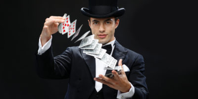 magician-showing-trick-with-playing-cards
