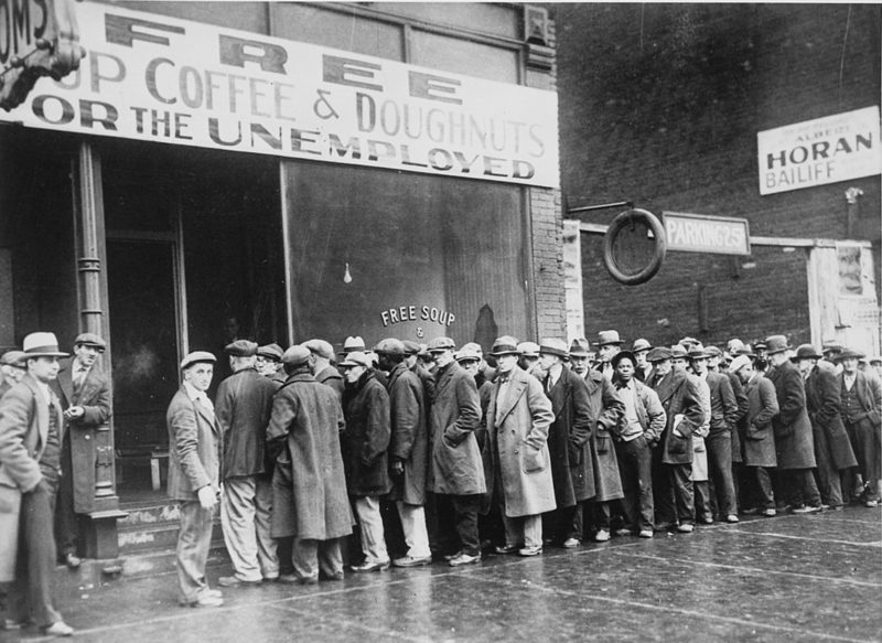 dustbowl_unemployed_men_queued_outside_a_depression_soup_kitchen_1931_-_nara