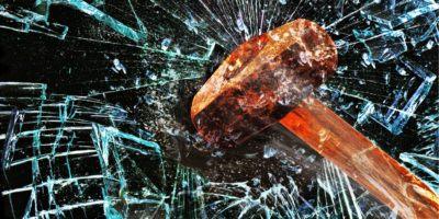 sledgehammer smashing glass
