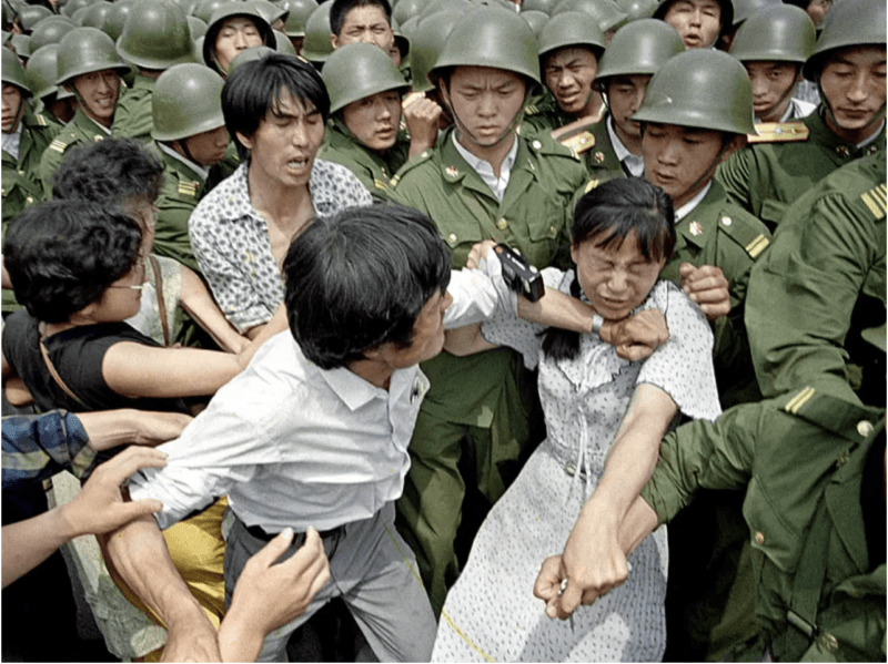 women removed by soldiers